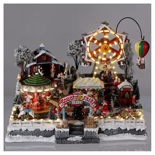 Christmas village 30x45x35 cm with moving fun fair, lights and music 2