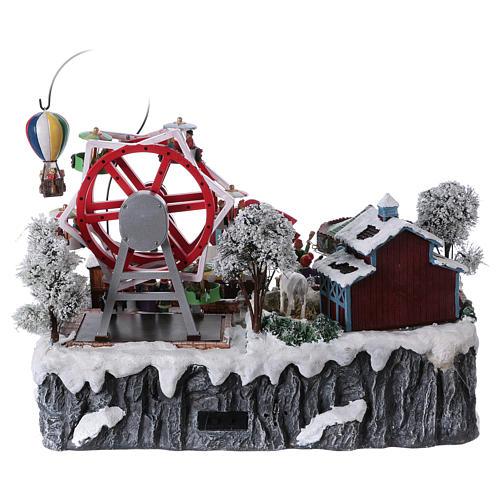 Pueblo de Navidad 30x45x35 cm con feria para niños luces movimieno música corriente 5