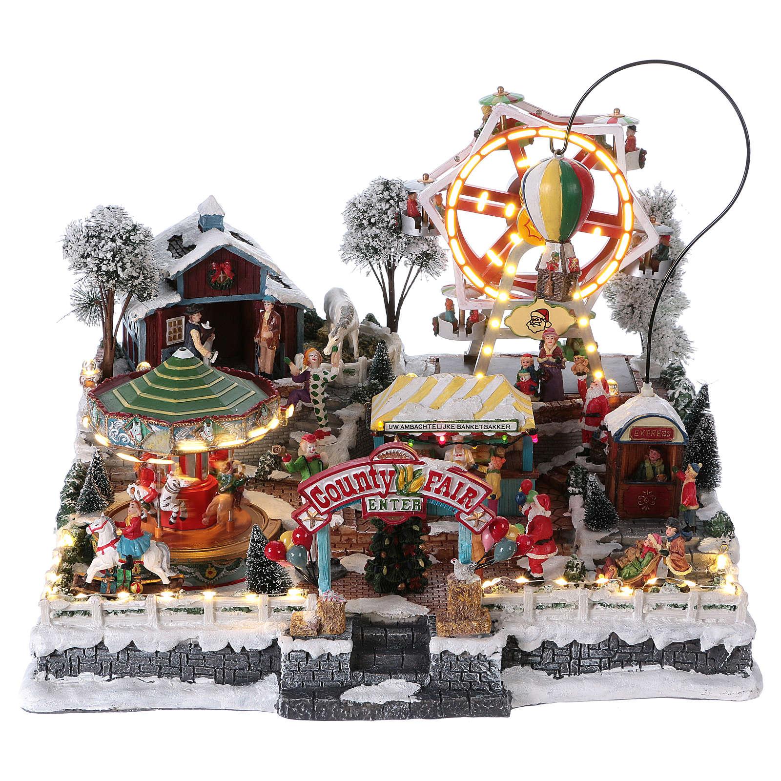 Village de Noël 30x45x35 cm avec fête foraine lumières mouvement musique courant électrique 3