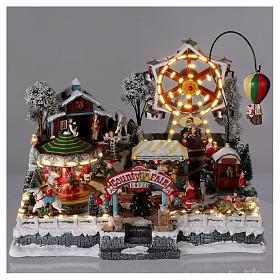 Village de Noël 30x45x35 cm avec fête foraine lumières mouvement musique courant électrique s2