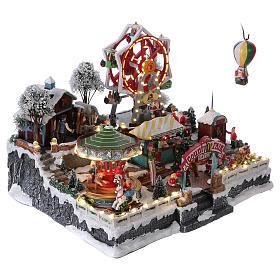 Village de Noël 30x45x35 cm avec fête foraine lumières mouvement musique courant électrique s4