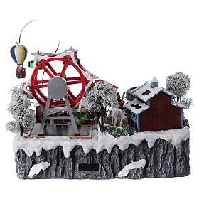 Village de Noël 30x45x35 cm avec fête foraine lumières mouvement musique courant électrique s5