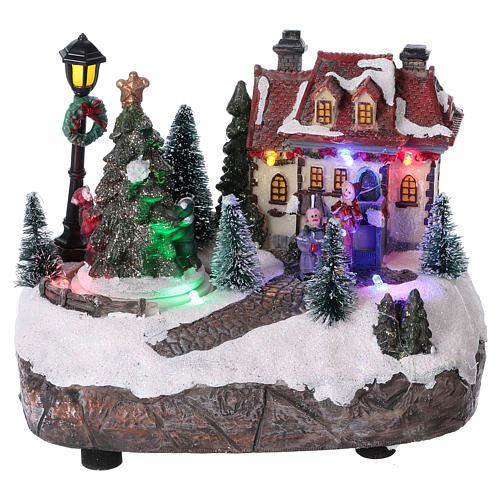 Village de Noël 15x20x10 cm avec sapin de Noël en mouvement piles 1