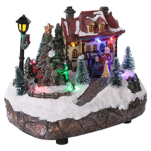 Village de Noël 15x20x10 cm avec sapin de Noël en mouvement piles 4