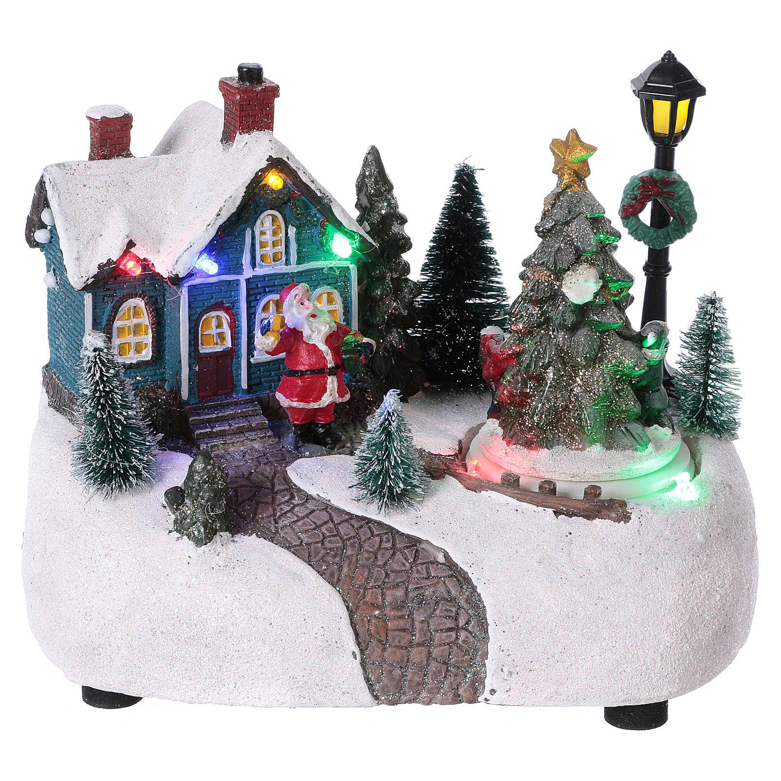 Pueblo de Navidad 15x20x10 cm con árbol en movimento batería 3