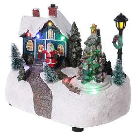 Pueblo de Navidad 15x20x10 cm con árbol en movimento batería s3