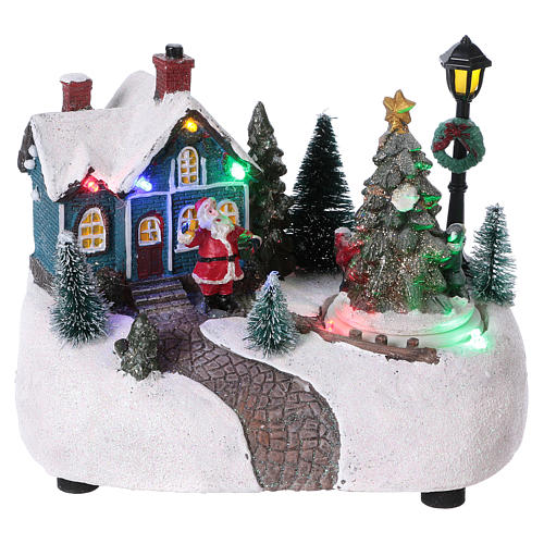 Pueblo de Navidad 15x20x10 cm con árbol en movimento batería 1