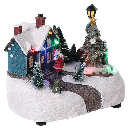 Pueblo de Navidad 15x20x10 cm con árbol en movimento batería 4
