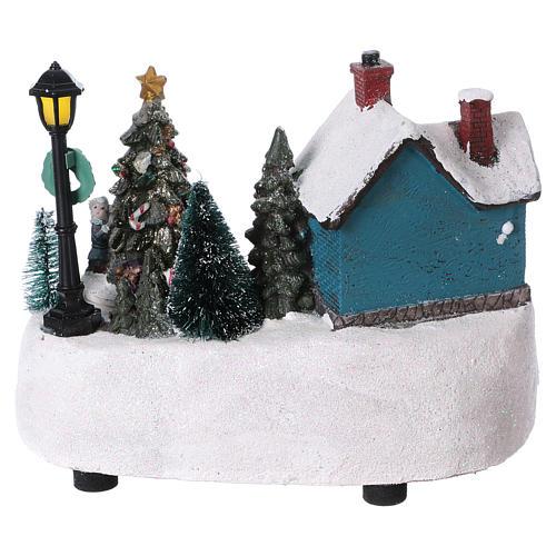 Pueblo de Navidad 15x20x10 cm con árbol en movimento batería 5