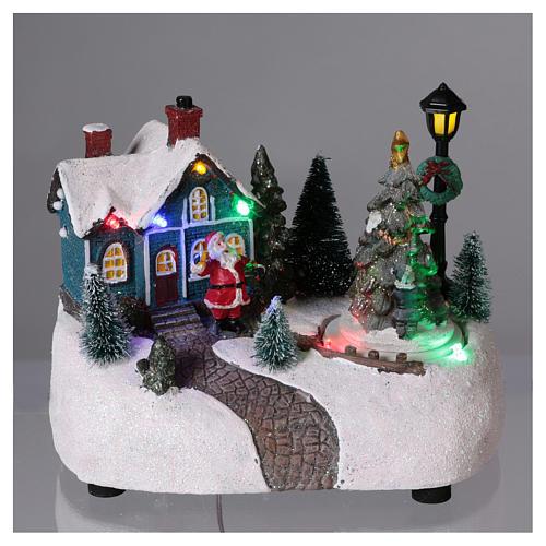 Village de Noël 15x20x10 cm avec sapin en mouvement piles 2