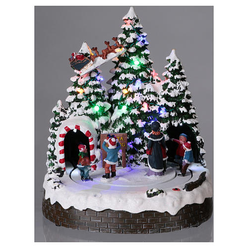 Christmas village with LED lights, moving children 30x25x25 cm 2