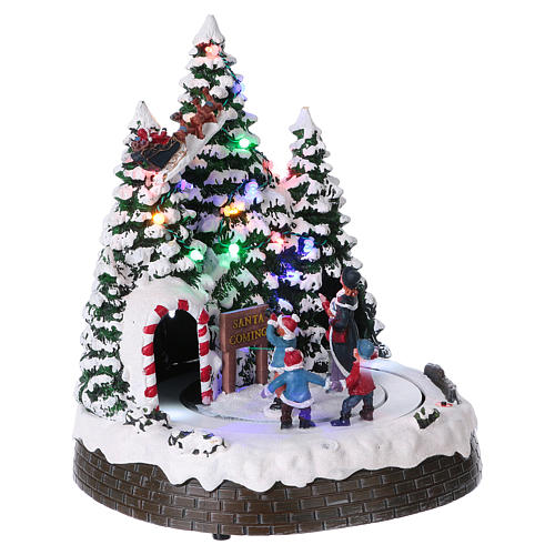 Christmas village with LED lights, moving children 30x25x25 cm 4