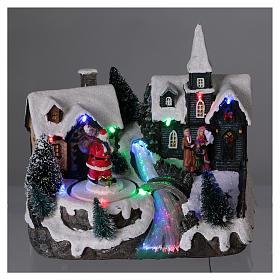 Pueblo de Navidad 20x20x15 cm Papá Noel movimiento batería s2