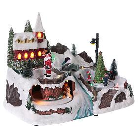 Escena navideña 20x30x20 cm Papá Noel patinadores movimiento batería s4