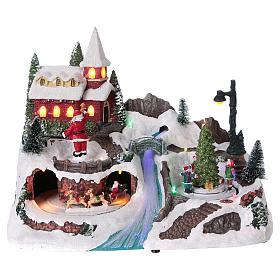 Scena natalizia 20x30x20 cm Babbo Natale pattinatori movimento batteria s1