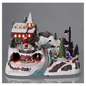Scena natalizia 20x30x20 cm Babbo Natale pattinatori movimento batteria s2