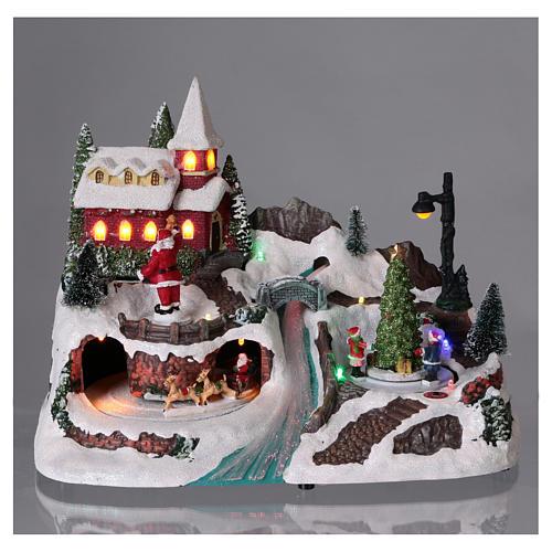 Scena natalizia 20x30x20 cm Babbo Natale pattinatori movimento batteria 2