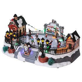 Christmas village with moving ice-skaters and gnome 20x40x25 cm s3