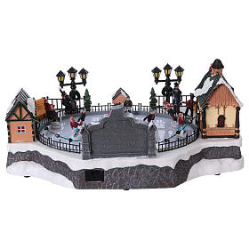Christmas village with moving ice-skaters and gnome 20x40x25 cm s5