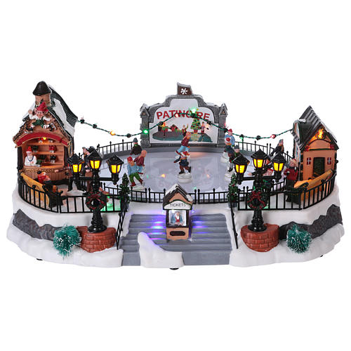Christmas village with moving ice-skaters and gnome 20x40x25 cm 1