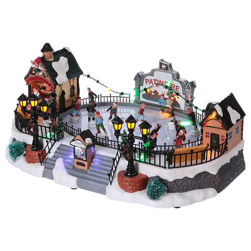 Christmas village with moving ice-skaters and gnome 20x40x25 cm 3