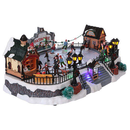 Christmas village with moving ice-skaters and gnome 20x40x25 cm 4