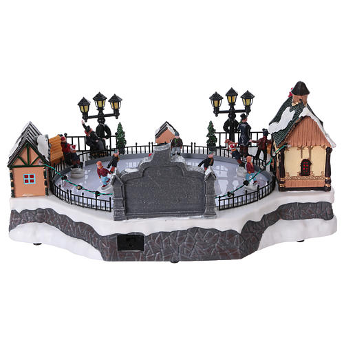 Christmas village with moving ice-skaters and gnome 20x40x25 cm 5