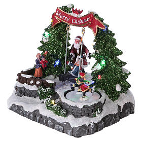 Christmas village with LED lights, moving ice-skaters and swing 20x25x20 cm s3