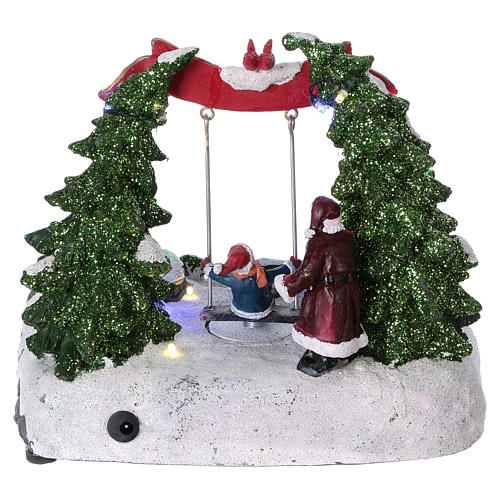 Christmas village with LED lights, moving ice-skaters and swing 20x25x20 cm 5
