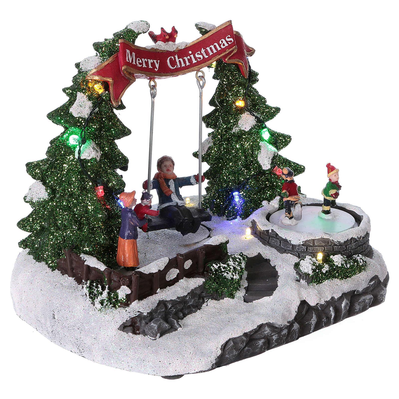 Escena navideña 20x25x20 cm patinadores y columpio en movimiento batería 3