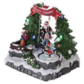 Décor Noël 20x25x20 cm patineurs et balançoire en mouvement piles s3