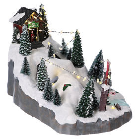 Christmas village 25x25x35 cm with moving skiers requiring batteries or electricity s4