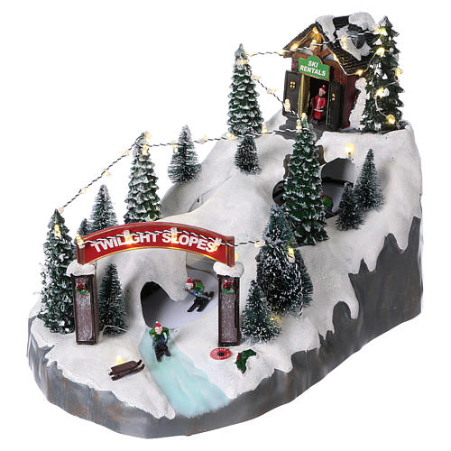 Christmas village 25x25x35 cm with moving skiers requiring batteries or electricity 3
