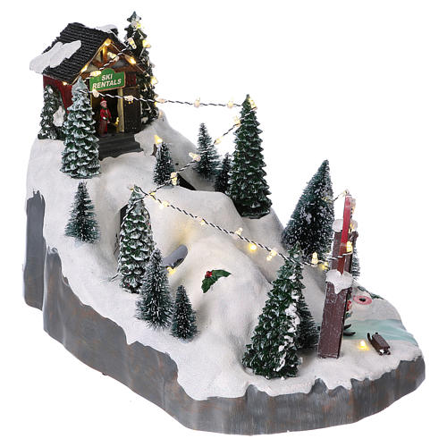 Christmas village 25x25x35 cm with moving skiers requiring batteries or electricity 4
