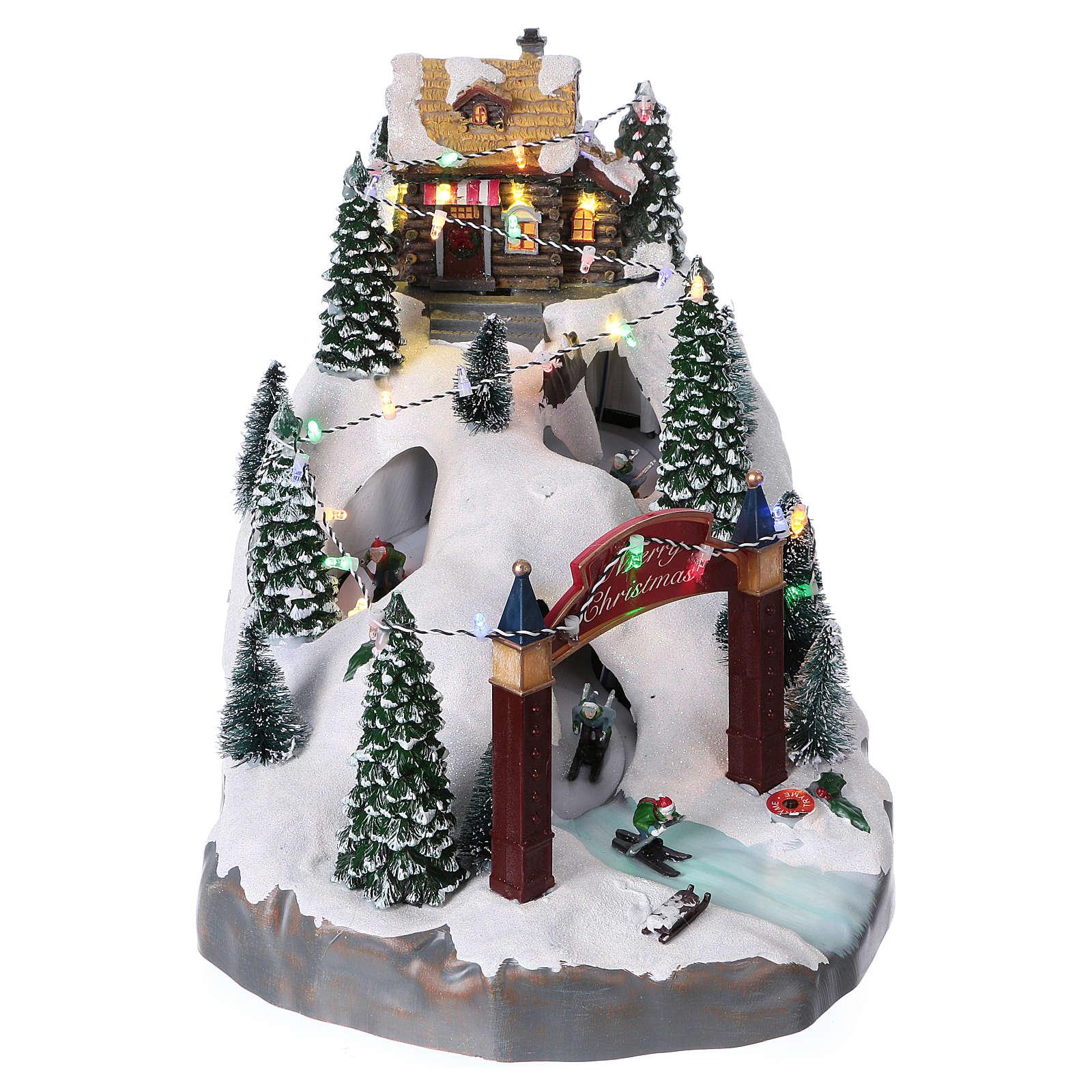 Pueblo navideño 25x25x35 cm con esquiadores movimento batería y corriente 3