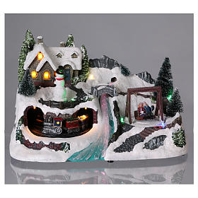 Christmas village with moving train and swing 20x30x20 cm s2