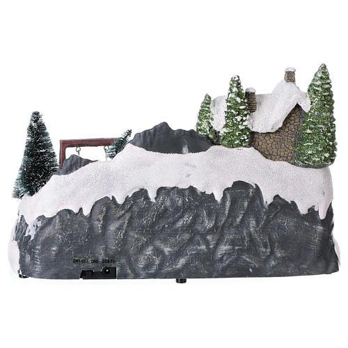 Pueblo navideño 20x30x20 cm tren y columpio en movimiento batería 5