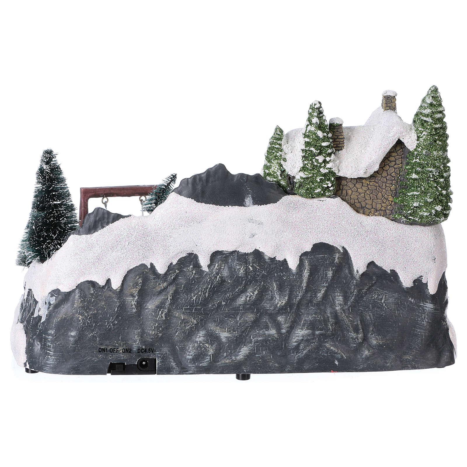 Villaggio natalizio 20x30x20 cm treno e altalena in movimento batteria 3