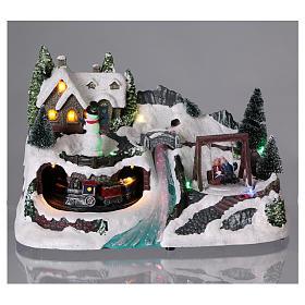Villaggio natalizio 20x30x20 cm treno e altalena in movimento batteria s2