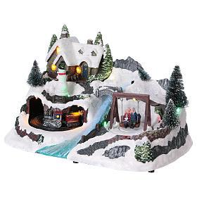 Villaggio natalizio 20x30x20 cm treno e altalena in movimento batteria s3