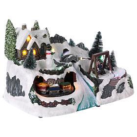 Villaggio natalizio 20x30x20 cm treno e altalena in movimento batteria s4