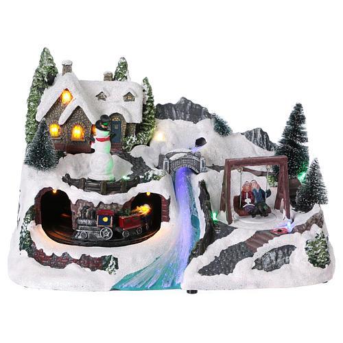 Villaggio natalizio 20x30x20 cm treno e altalena in movimento batteria 1