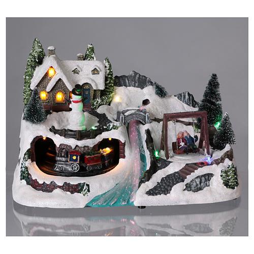 Villaggio natalizio 20x30x20 cm treno e altalena in movimento batteria 2