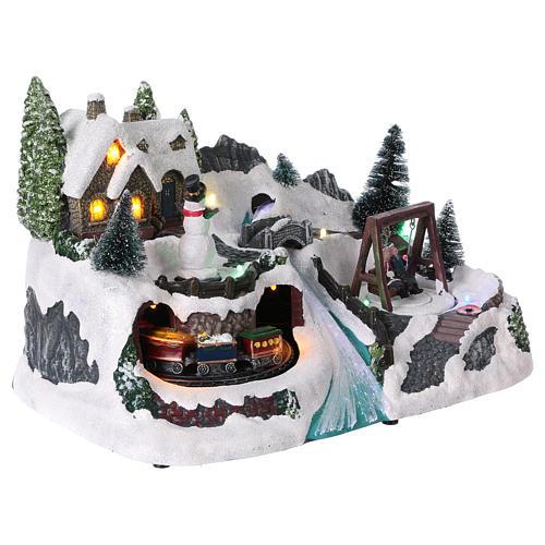 Villaggio natalizio 20x30x20 cm treno e altalena in movimento batteria 4