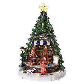 Winterszene Tannenbaum und Spielengeschäft 30x25x25cm Licht und Musik s1
