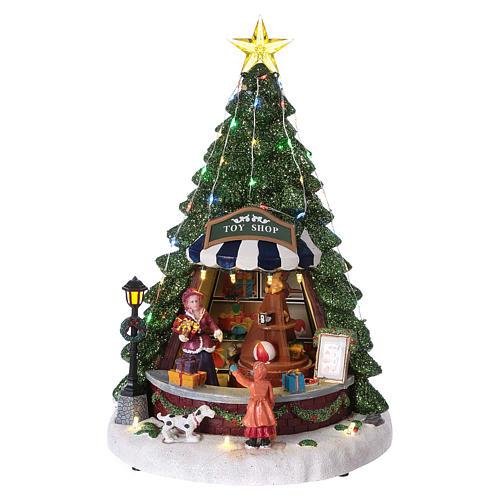 Winterszene Tannenbaum und Spielengeschäft 30x25x25cm Licht und Musik 1