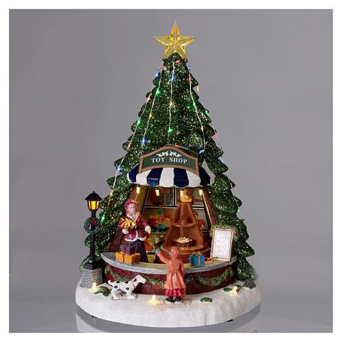 Winterszene Tannenbaum und Spielengeschäft 30x25x25cm Licht und Musik 2