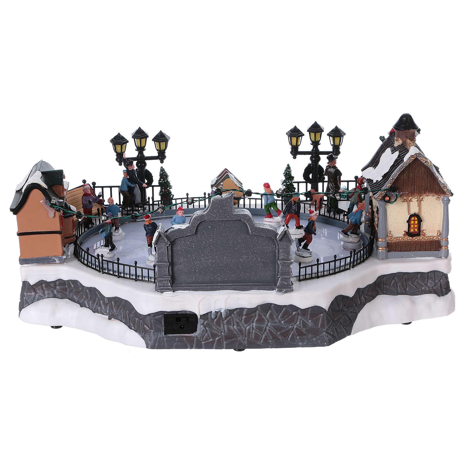 Escena Navidad 20x40x25 cm patinaje mov Papá Noel corriente 3