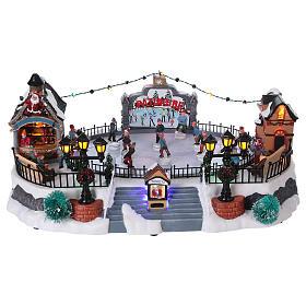 Scenografia Natale 20x40x25 cm pattinaggio mov Babbo Natale corr s1