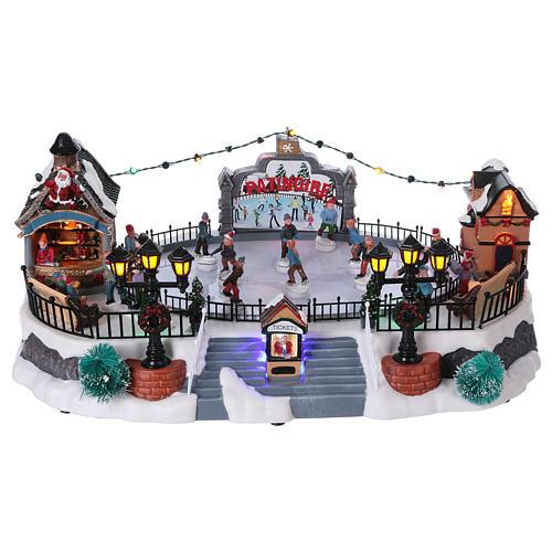 Scenografia Natale 20x40x25 cm pattinaggio mov Babbo Natale corr 1